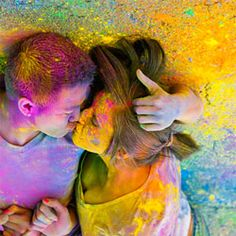 A colorful engagement session with a chalk fight