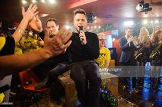 Olly Murs (C) and Chris Evans (right of centre) during the recording of 'TFI Friday' New Year's Eve special at the Cochrane Theatre on December 31, 2015 in London, England.