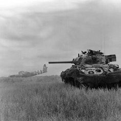 A Sherman tank of Royal Hussars in action against German troops using crashed Horsa gliders as cover near Ranville, 10 June 1944 World Of Tanks, D Day Normandy, Sherman Tank, Army Vehicles, Armored Vehicles, Tank Destroyer, Armored Fighting Vehicle, Ww2 Tanks, War Photography