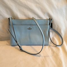 Coach Light Blue Crossbody Authentic Coach crossgrain leather. Flat Crossbody style. Silver hardware. Smoke free home. Used once. Zero flaws! Coach Bags Crossbody Bags