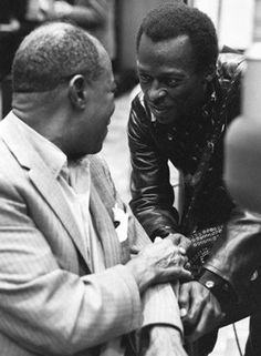Louis Armstrong and Miles Davis