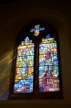 Vibrant rainbow colours beaming through church's stained glass window.