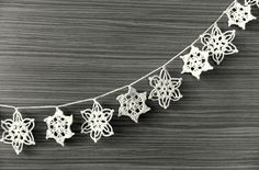Handmade holiday ornaments, Snowflakes garland, Crocheted Christmas decoration, white. $35.00, via Etsy.