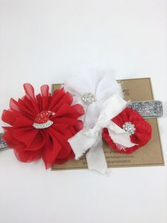 Happy Holidays with this Rhinestone center Silver Sparkle Headband! A Red Ballerina Flower with a Santa Hat Rhinestone center on Silver Glitter FOE
