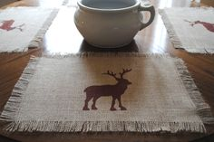 Burlap placemats w/ Moose stencil.for my future cabin ;) Could do a tree or ornament for XMas Rustic Christmas Crafts, Rustic Crafts, Christmas Fun, Christmas Decorations, Xmas, Diy Arts And Crafts, Diy Crafts, Moose Crafts, Table Dressing