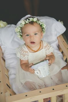 Ryan, our then seven-month-old daughter, served as the flower baby in a custom gown by Stone Cold Fox.