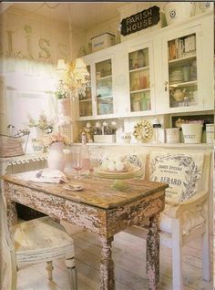 charming shabby chic kitchen. not sure if the chipped paint would get on my nerves after a while