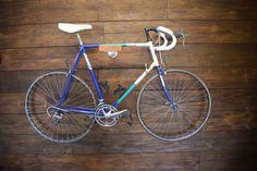 Oak and Steel Minimalist Bicycle Bike Wall   Etsy Bicycle Wall Hanger, Bicycle Wall Mount, Bike Rack, Dark Hardwood, Oak Stain, Large Frames, Black Stains, Steel Wall, Galvanized Steel
