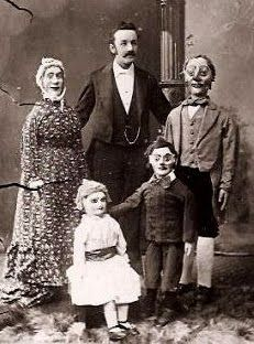 The stuff nightmares are made from...Vintage photo of a Ventriloquist with his family of dummies.