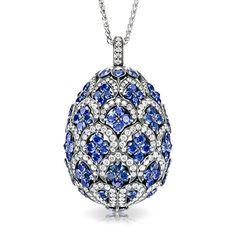 ZÉNAÏDE SAPPHIRE EGG PENDANT LOCKET  One of a series of three exceptional Fabergé egg locket pendants, designed in the graphic style of traditional Uzbek textiles, and named for the Princess ZénaÏde Yusupov, This egg, in white gold, black rhodium-plated to create an antique-style patina.   This piece is set in 18 carat white gold and features blue sapphires and white diamonds.