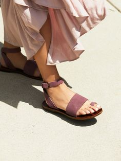 Torrence Flat Sandal | Essential flat sandal featuring a suede design with over-the-foot closures. Adjustable strap wraps effortlessly around the ankle.