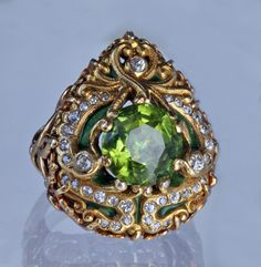 Gold, enamel, peridot & diamond MARCUS & CO Superb Art Nouveau Ring in the Moghal Style (c. 1905 United States)