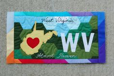 American Made Brand WV License Plate Complete by Sarah.WV, via Flickr