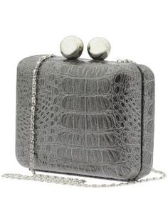I think my sister might like this, she loves clutches and this has such a great rock and roll vibe with the snakeskin.