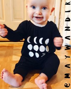 Baby harem style coveralls made from bamboo fabric with hand painted lunar phases. I love this outfit!!! It was fun to make and so comfy for my little honey.