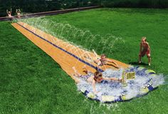 Make your slip 'n' slide racing dreams come true with the two-person slip and slide. Rather than wait for you buddy to finish his ride, simply hop on beside him and see if you can beat him to the small pool located at the finish line. Best Slip And Slide, Slip N Slide, Outdoor Fun, Outdoor Gear, Man Cave Must Haves, Kids Backyard Playground, Picnic Blanket, Outdoor Blanket, Pop Goes The Weasel