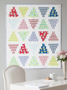 This quilt pattern featured in Quilty September/October 2013 features stacked pyramids in modern quilt fabrics. This pattern is kicky and cute as can be. Quilt by Jeni Baker.