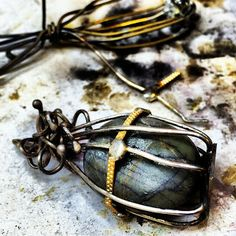 let the beauty we love be what we do A beautiful caged pendant by Ruth Rae.