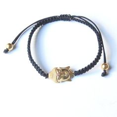 This gorgeous black macrame buddha bracelet features an 18K gold plated sterling silver sideways flat back buddha (0.4 x 0.6 inches) with a small