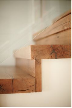 Natural wood treads and risers with simple, transparent guard.