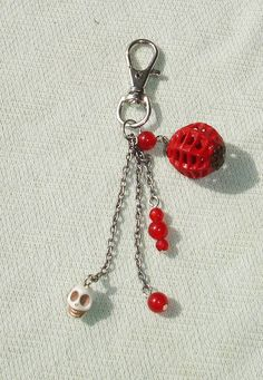 """I made this beaded key ring with red gemstone beads, howlite skull bead, and mini Chinese lantern. Makes a great purse charm! Measures 4"""" long."""