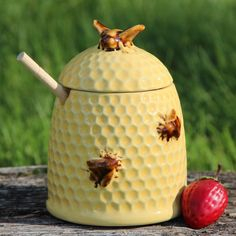 """Our vintage inspired golden yellow honey pot will add sunny charm to your breakfast table! Overall height 5.75"""". Dipper is 6.25"""""""" long. Top rim is 3"""" Diameter, Base is 4"""" across. This delightful stone"""