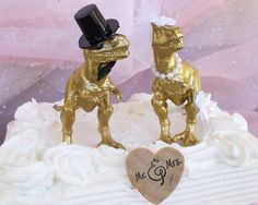 Hey, I found this really awesome Etsy listing at https://www.etsy.com/listing/240925126/dinosaur-wedding-cake-topper-gold