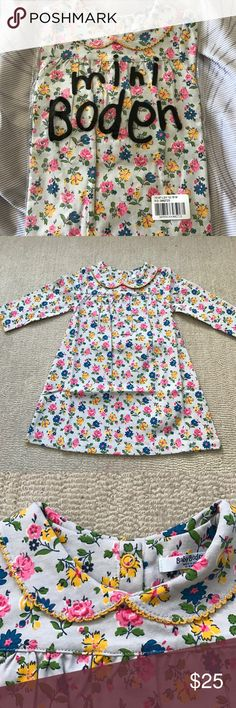 Mini Boden Baby Girl Dress with Flower Print New without tags Mini Boden baby girl's dress with multi color flower print against a pale gray background. Comes in original plastic shipping. Snap buttons in the back. Mini Boden Dresses Casual