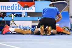 Rafael Nadal of Spain receives a back massage in his men's final match against Stanislas Wawrinka of Switzerland during day 14 of the 2014 A...