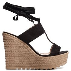 Black platform with suede texture and wedge with woven look. Fastens with laces.