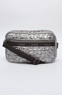 They hate when you don't follow the rules at festivals. This purse is festival size and will fit your necessities (wallet, phone unopened cigarettes etc)    LeSportsac Bag Crossbody Metallic Soho Quilted Zip Adjustable Strap Silver: Miss KL    #MissKL #MissKLCoachella