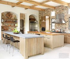 For a kitchen with large square footage, try two islands to separate cooking and serving areas.