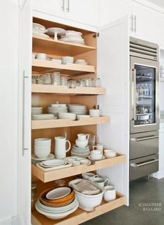 Slide out kitchen pantry drawers by Heather Bullard More