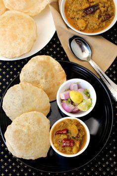Aloo Rasedar recipe, a gem among many styles of Utter Pradesh aloo recipes with no onion and no garlic. Puri Rasedar Aloo ki sabzi , best North Indian food.