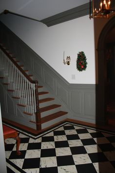 FARMHOUSE – INTERIOR – The staircase, paint color, and wainscoting are beautiful.