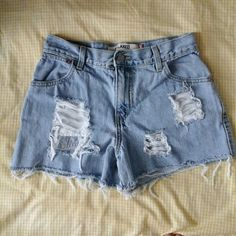 """High Waisted Distressed Levi's These go with everything, and they're super cute! Custom distressed light wash Levi's shorts, waist measures 28"""" but could fit a 27 was well! :) Urban Outfitters Shorts Jean Shorts"""