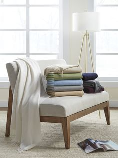 Dorsey, our pure cashmere throw, is finished with a fine downy watermark effect and a flounce of fringe.