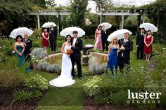 so cute! If not with umbrellas, I like the way the couples are separated... we are having all couples in the wedding party...