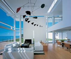 Beach Houses – Oceanfront Design with White Exteriors and Interiors