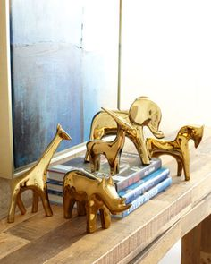 Golden Animal Sculptures by Dwell Studios by Global Views at Neiman Marcus.