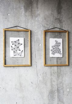 Concrete wall - black and white art in oak frames by Moebe