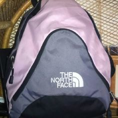 NORTH FACE gray/soft pink/black Backpack This is in great condition! Used only a few times. It's smaller than a standard large backpack and still fits a lot of stuff!  Zippered separate pockets in front and on the side. North Face Bags Backpacks