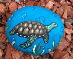 A personal favorite from my Etsy shop https://www.etsy.com/listing/562862676/hand-painted-sea-turtle-on-a-beach-rock