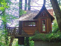 This treehouse reflects the Storybook Style of architecture seen in Carmel-by-the-sea, California. Windows are reclaimed or handmade, and the siding is beautiful reclaimed cedar. The interior has a sitting area and sleeping loft for the 3 children.