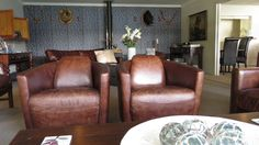 Comfy leather seats situated in the lounge of Kingfish Lodge