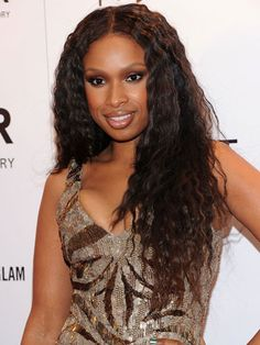 Crimping (the non-'80s way) is one of the easiest things you can do with a flat iron — and the effect is subtle and current, not dated.To create a cool crimp like Jennifer Hudson's, starting with straight locks, grab a one-inch section of hair and position your flat iron at the root. Begin twisting your wrist back and forth, slowly, as you glide the iron all the way down to your ends. Repeat until all strands have been tended to. Getty Images -Cosmopolitan.com