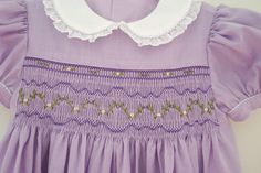 "Made by Linda Regan Creamer. Plate: ""Adelaide"" by Cynthia Finnerty. Dress: ""Basic Yoke"" by Chery Williams. Piped in lavender whip stitch piping."