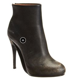Martin Margiela boots. Love the hole in the arch of the shoe.