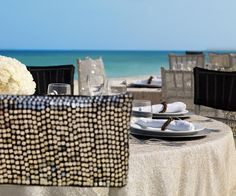 Sequined chairs and neutral table setting for beach wedding reception | Metallic Sands Collection at Palace Resorts #destinationwedding
