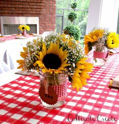 Sunflowers and Baby's Breath in mason jars for an I Do BBQ.